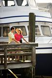 Couple at dock looking at each other.