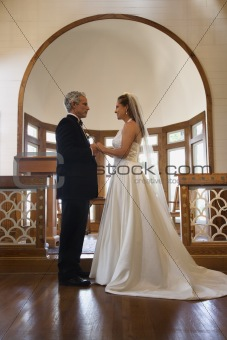 Bride and groom in church.