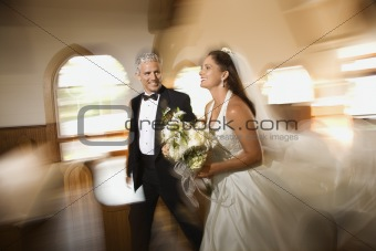 Bride and groom leaving church.