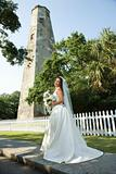 Bride with lighthouse in background.