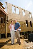 Man and woman on construction site.