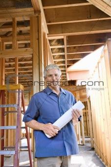 Caucasian man on construction site.