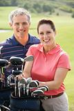 Portrait of smiling couple playing golf