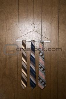 Three retro ties on hanger.