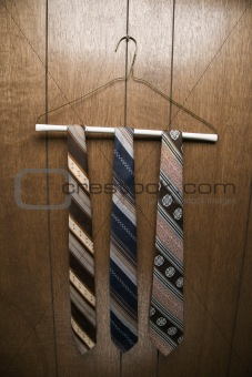 Three retro ties on hanger.