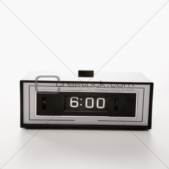 Retro clock set for 6:00.
