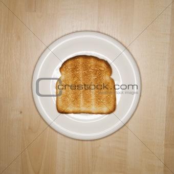 Slice of toast on plate.