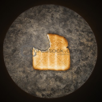 Slice of toast with bite missing.