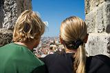 Caucasian woman and boy looking at view in Lisbon, Portugal.