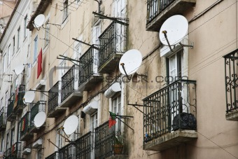 Apartment building with satellite dishes in Lisbon, Portugal.