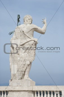 Roman statue with blue sky in Rome, Italy.