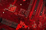 close up of red circuit plate