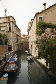 Canal with boats and buildings in Venice, Italy.