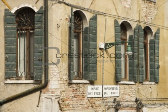 Arched windows with shutters in Venice, Italy.