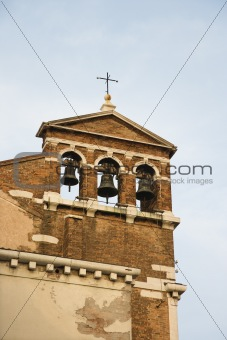 Church belfry with three bells in Venice, Italy.