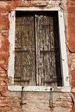 Worn building with window in Venice, Italy.