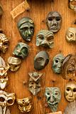 Masks hanging on wall.