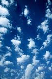 Cumulus clouds in blue sky.