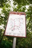 Sign with map showing routes.