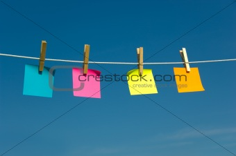 Four Sticky notes on a clothesline
