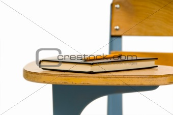 Closeup of school desk with book
