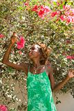 Woman smelling bougainvillea flower.