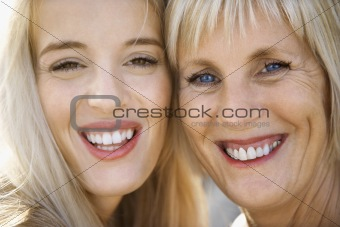 Mom and daughter smiling.