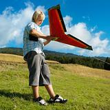 Boy preparing to fly remote controlled airplane.