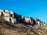 Mountain range against blue sky.