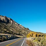 Highway cutting through montain range.
