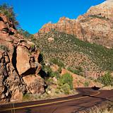 Road winding through cliffs in Zion National Park, Utah.