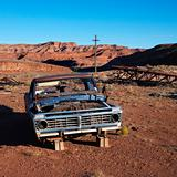 Old abandoned junk car in the desert.