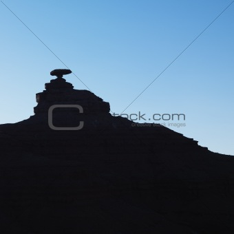 Silhouette of Mexican Hat rock formation in Utah.