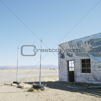 Building in barren desert landscape.