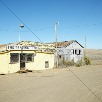 Old trading post in desert landscape of Utah.