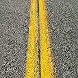 Close-up of double yellow lines in road.