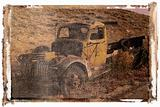 Polaroid transfer of old pickup abandoned on hill.