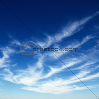 Cirrus clouds in blue sky.