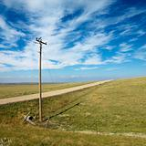 Power lines alongside dirt road in rural South Dakota.