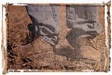 Polaroid transfer of man in workboots.