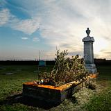 Tombstone memorial in rural cemetary.
