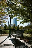 Empty bench in urban park in Atlanta, Georgia.