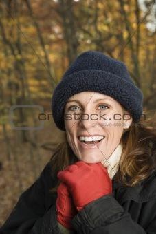 Smiling Caucasian woman portrait in woods.