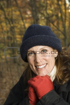 Smiling Caucasian woman portrait in woods.
