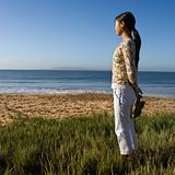 Woman standing on beach.