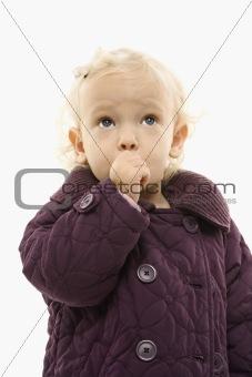 Female toddler sucking her thumb.