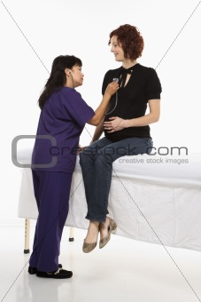 Pregnant woman having vital signs checked.