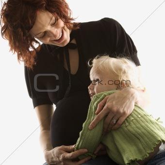 Pregnant woman hugging her daughter.