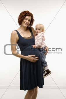 Pregnant woman holding child.