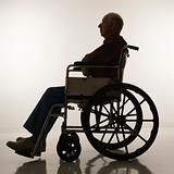 Silhouette of elderly man in wheelchair.